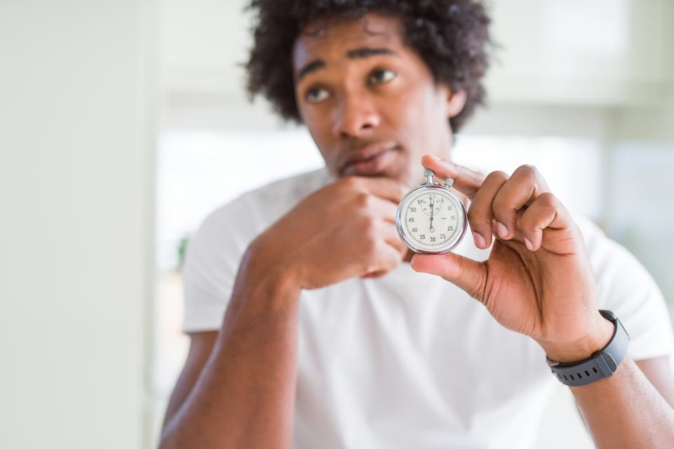Getty Employee Holding Watch